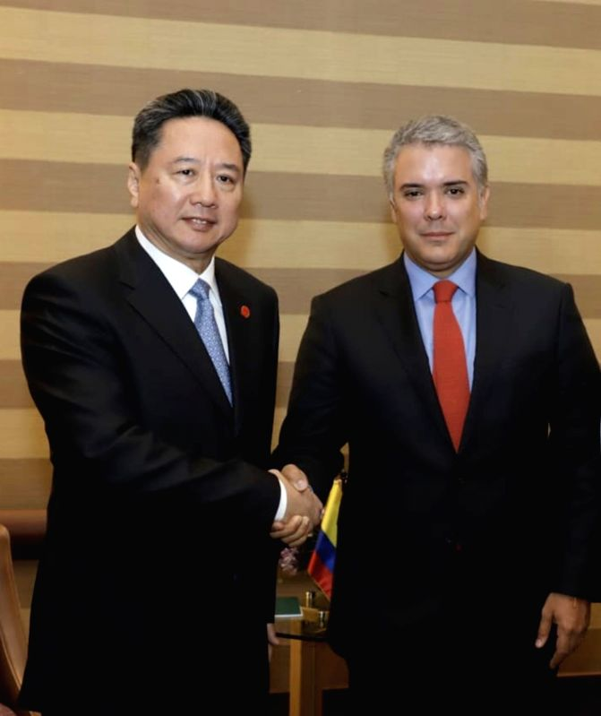 BOGOTA, Aug. 9, 2018 - Chinese President Xi Jinping's special envoy Li Xiaopeng (L), also the transport minister, meets with Colombian President-Elect Ivan Duque before attending the Colombian ...