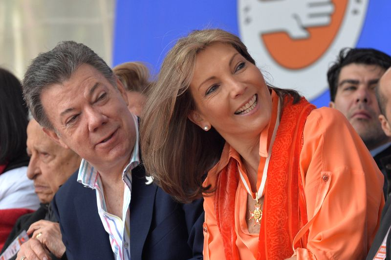 Image provided by Colombia's Presidency shows Colombian President Juan Manuel Santos (L) and his wife Maria Clemencia Rodriguez taking part in the opening ceremony