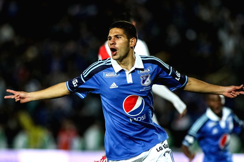 Jonathan Agudelo of Colombia's Millonarios celebrates after scoring against Argentina's River Plate, during a match to pay tribute to late former Argentine soccer ...
