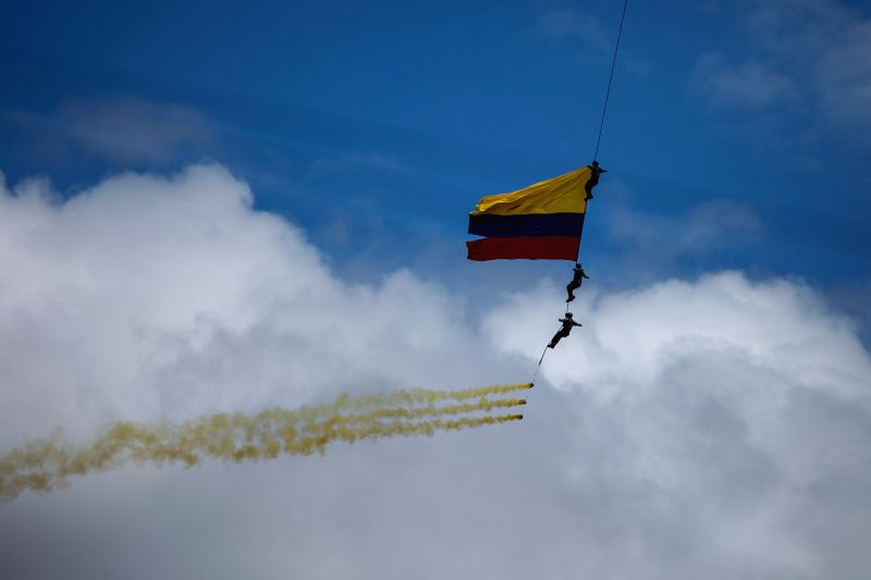 Soldiers of the Air Force perform acrobatics during the annual military parade for the celebration of Independence Day, in Bogota city, capital of Colombia, on July .
