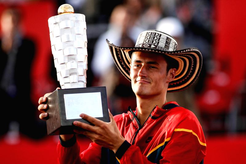 Bernard Tomic of Australia poses with the trophy after the final against Ivo Karlovic of Croatia at the Claro Open Colombia in Bogota, Colombia on July 20, 2014. ...