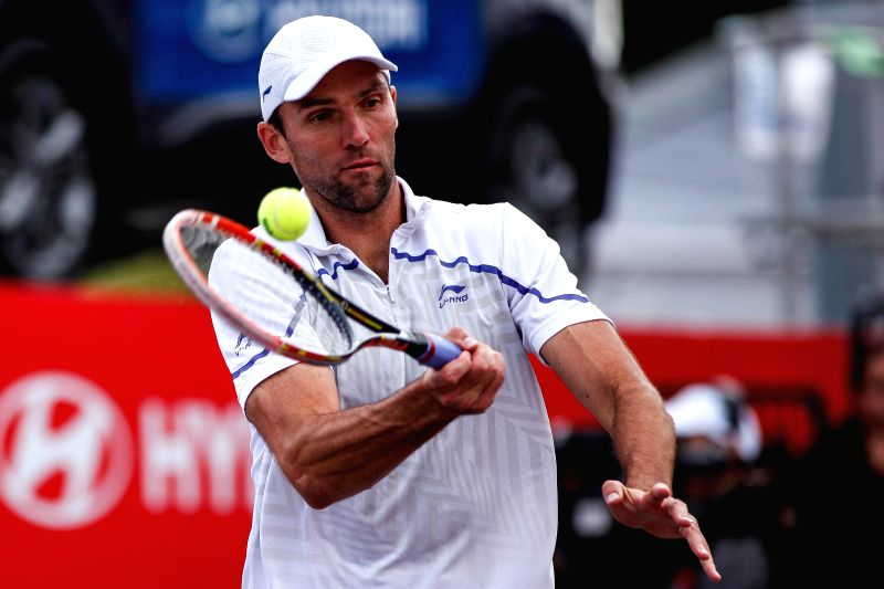 Ivo Karlovic of Croatia returns the ball during the final against Bernard Tomic of Australia at the Claro Open Colombia in Bogota, Colombia on July 20, 2014. Ivo ...