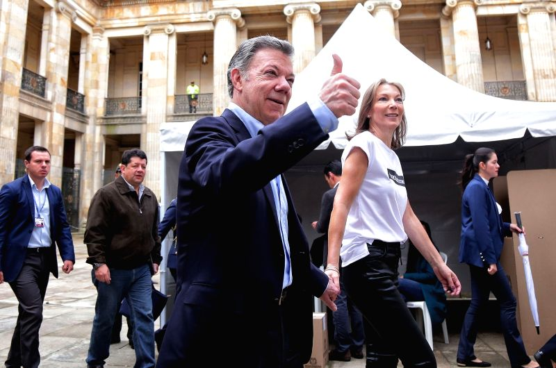 BOGOTA, June 17, 2018 - Colombian President Juan Manuel Santos (Front) gestures after voting at a polling station in Bogota, Colombia, on June 17, 2018. A total of 11,233 polling stations opened on ...