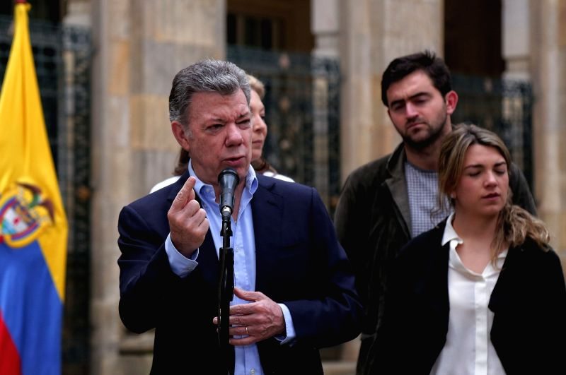 BOGOTA, June 17, 2018 - Colombian President Juan Manuel Santos (Front) delivers a speech in Bogota, Colombia, on June 17, 2018. A total of 11,233 polling stations opened on Sunday morning to allow ...