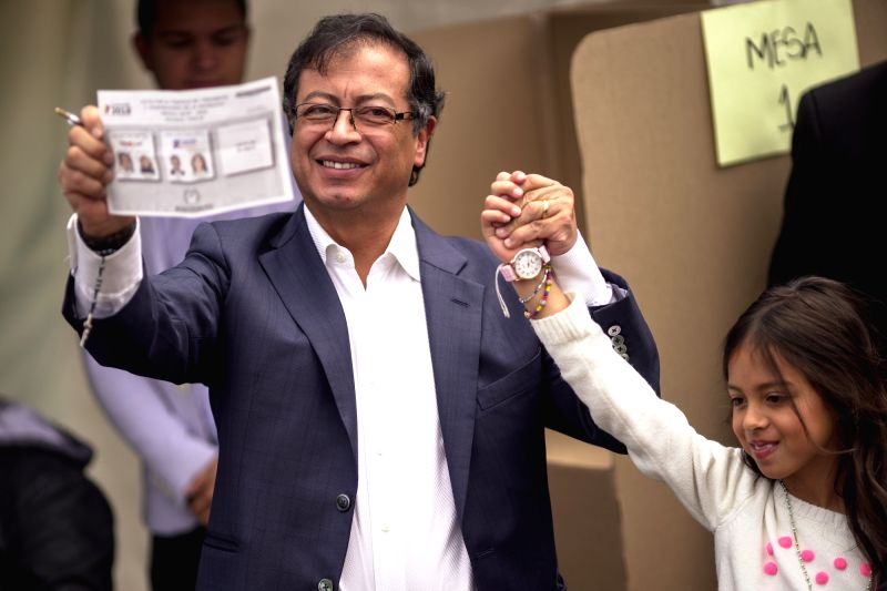 BOGOTA, June 17, 2018 - Colombian presidential candidate Gustavo Petro (L) attends the second round of presidential voting at a polling station in Bogota, Colombia, on June 17, 2018. A total of ...