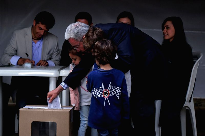 BOGOTA, June 17, 2018 - Former Colombian President Alvaro Uribe (C) casts his ballot at a polling station in Bogota, Colombia, on June 17, 2018. A total of 11,233 polling stations opened on Sunday ...