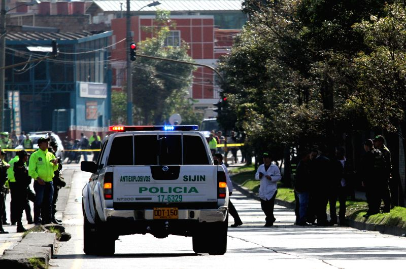 A police vehicle is seen at the blast site in Quiroga neighborhood in Bogota, Colombia, on March. 12, 2015.  A bomb was exploded as a caravan of 30 policemen ...