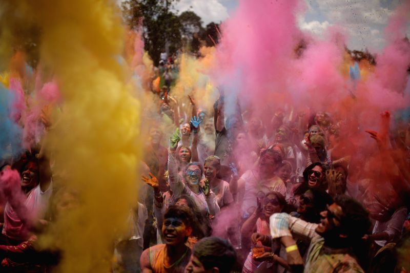 Residents take part in the Holi Festival, also known as Spring or Color Festival in Bogota city, capital of Colombia, on March 15, 2015.
