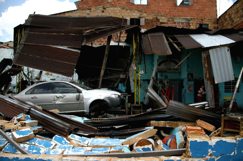 Debris remain in front of a house on a street after heavy rains in the city of Bogota, Colombia, on March 23, 2015. According to local press, several sectors of the ...