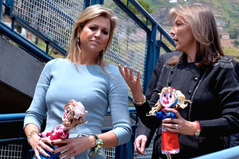 Image provided by Colombia's Presidency shows Colombian First Lady Maria Clemencia Rodriguez (R) talking with Queen Maxima, of the Netherlands, during their ...