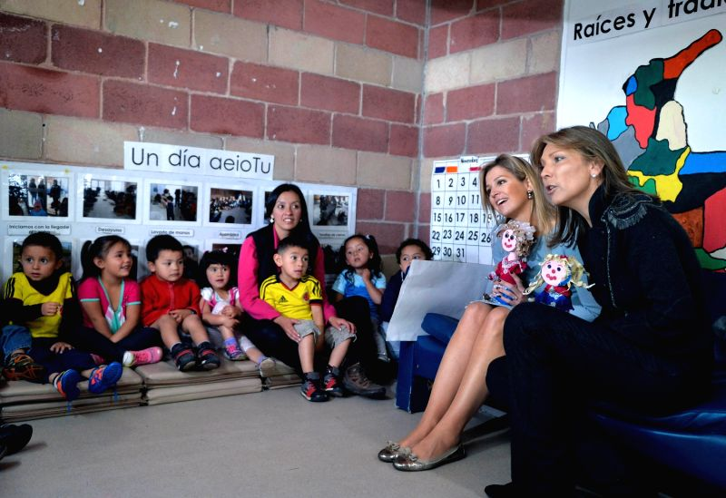Image provided by Colombia's Presidency shows Colombian First Lady Maria Clemencia Rodriguez (R) and Queen Maxima (2nd R), of the Netherlands, interacting with .