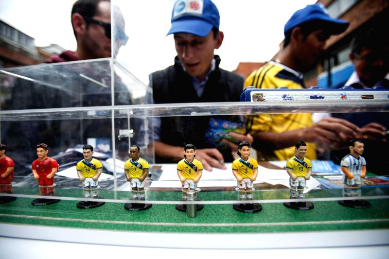 Image taken on May 9, 2014 shows a man selling figures of soccer players, in Bogota, capital of Colombia.