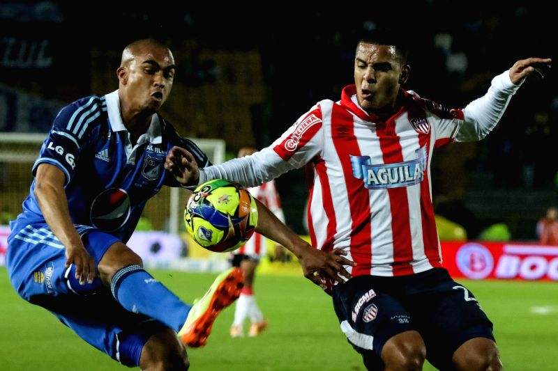 Lewis Ochoa (L) of Millonarios vies for the ball with Cesar Fawcett of Atletico Junior during their semifinal match of Colombian Championship, held at Nemesio Camacho