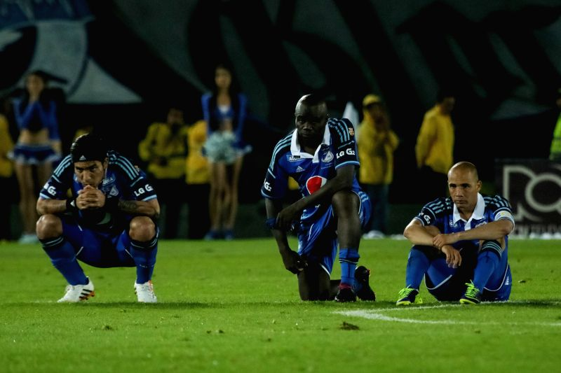Players of Millonarios react at the end of a semifinal match of Colombian Championship against Atletico Junior, held at Nemesio Camacho Stadium, in Bogota, capital of