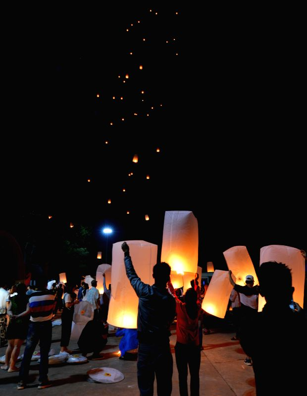 BOKEO, Jan. 28, 2018 - People fly lanterns during the Kapok festival in Bokeo province, Laos, Jan. 27, 2018.
