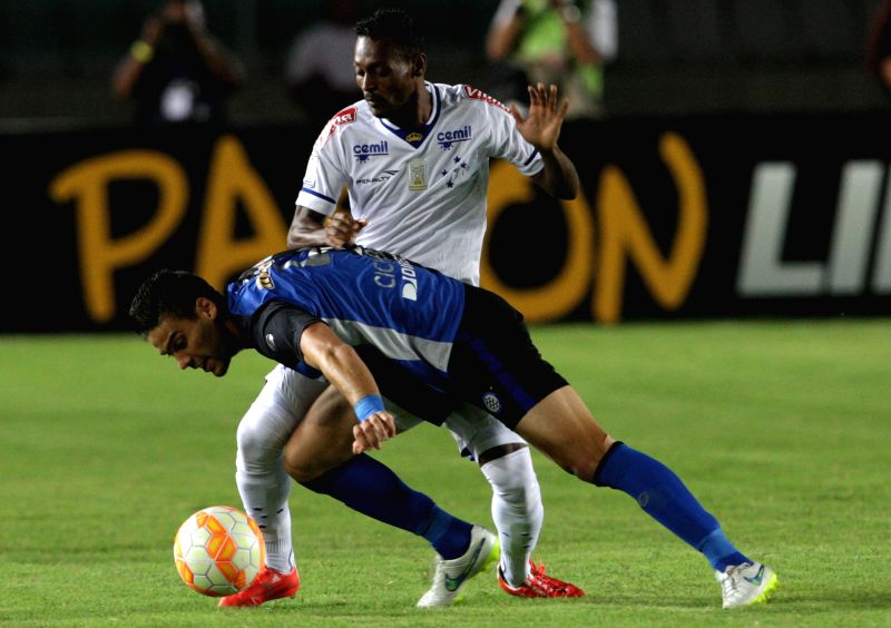 Gabriel Cichero of Venezuela's Mineros de Guayana vies with Marquinhos of Brazil's during their Libertadores Cup Group 3 match at Cachamay Stadium in Puerto Ordaz, ...