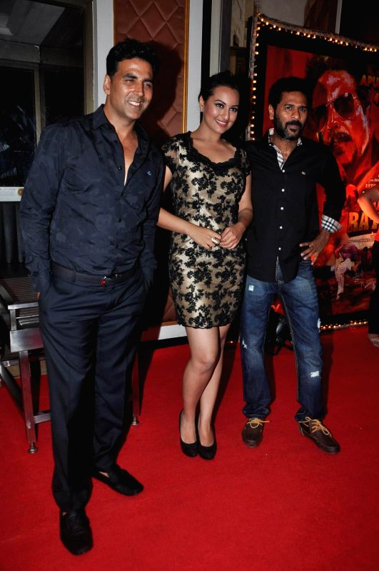 Bollywood actor Akshay Kumar, actress Sonakshi Sinha and Prabhu Deva pose during the success bash of their movie 'Rowdy Rathore' held at Taj Lands End. - Akshay Kumar and Sonakshi Sinha