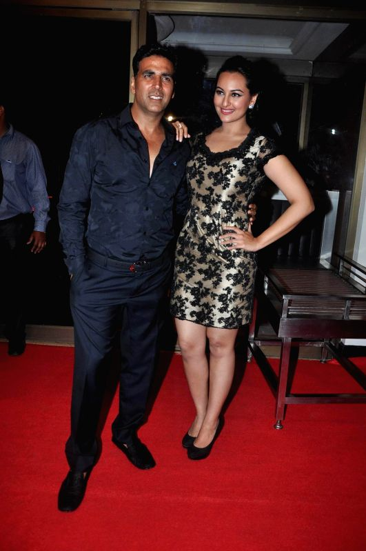 Bollywood actor Akshay Kumar and actress Sonakshi Sinha pose during the success bash of their movie 'Rowdy Rathore' held at Taj Lands End. - Akshay Kumar and Sonakshi Sinha