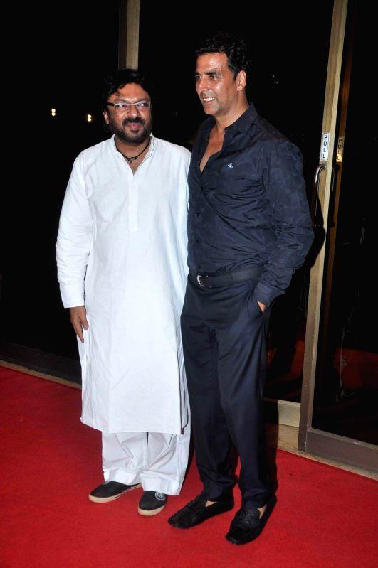 Bollywood actor Akshay Kumar and Sanjay Leela Bhansali pose during the success bash of their movie 'Rowdy Rathore' held at Taj Lands End. - Akshay Kumar