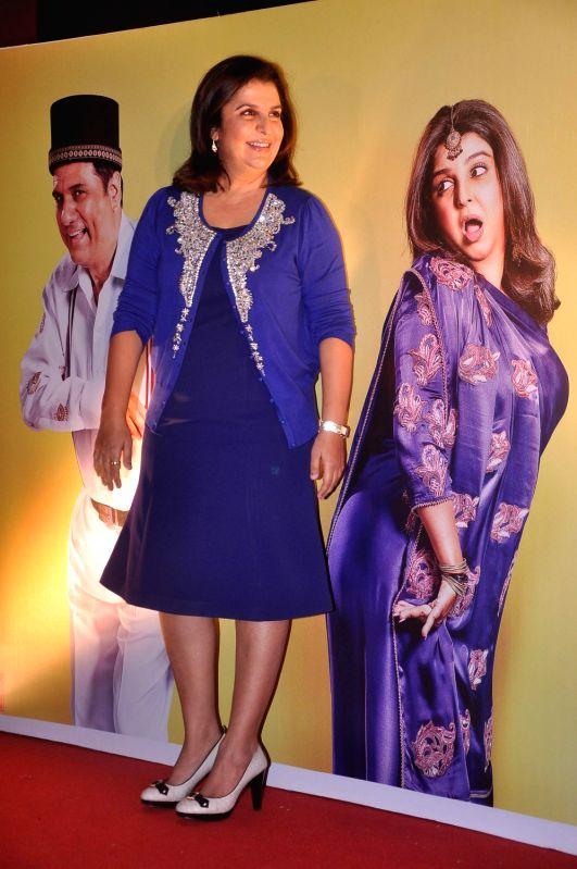 Bollywood actor Boman Irani and Choreographer-turned-filmmaker Farah Khan in the first look poster of `Shirin Farhad Ki Toh Nikal Padi` at Cinemax. - Boman Irani and Farah Khan