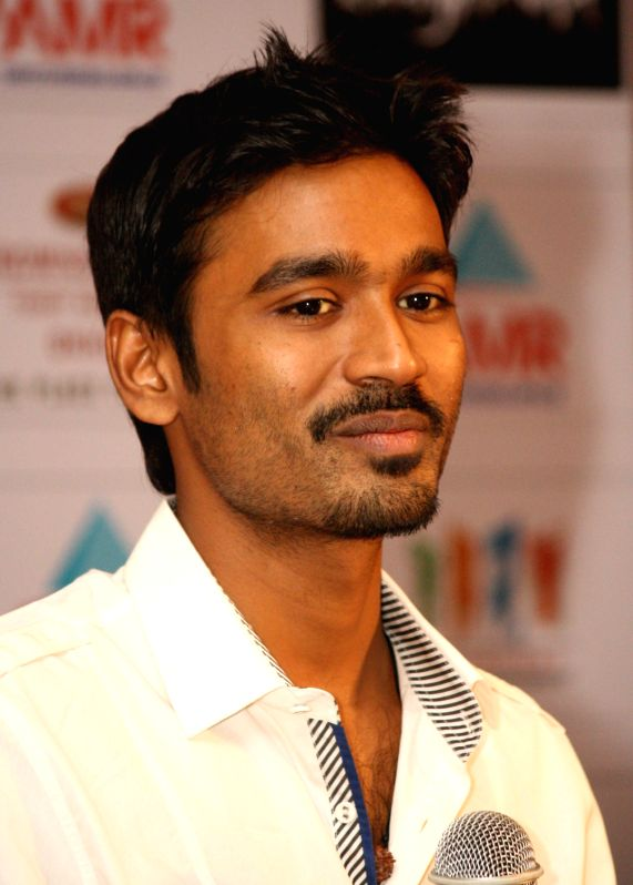 bollywood actor dhanush at a press meet for their film