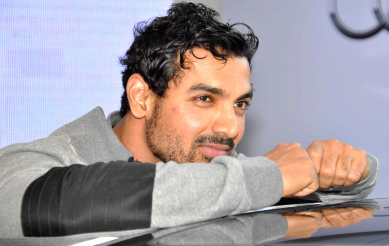 Bollywood actor John Abraham and Gul Panag at a promotional event of Audi in New Delhi.