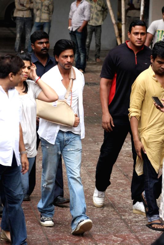 Bollywood actor Shahrukh Khan attend the funeral of Bollywood actress Priyanka Chopra`s father ...