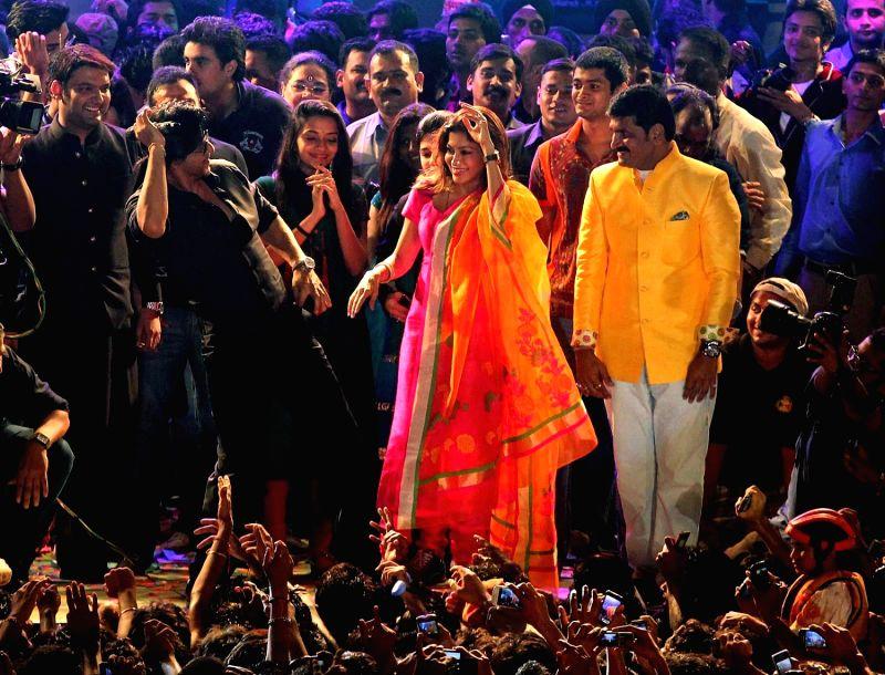 Bollywood actor Shahrukh Khan during the Janmashtami celebration in Mumbai on August 29, 2013. - Shahrukh Khan