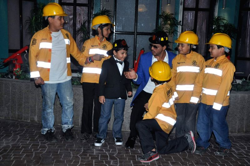 Bollywood actor Shahrukh Khan launches his new business venture - KidZania in Mumbai on August 29, 2013.