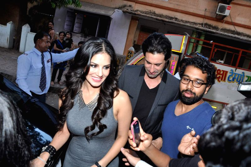 Bollywood actor Sunny Leone along with her husband Daniel Weber during the launch of men`s magazine Mandate April issue, in Mumbai, on April 10, 2014.