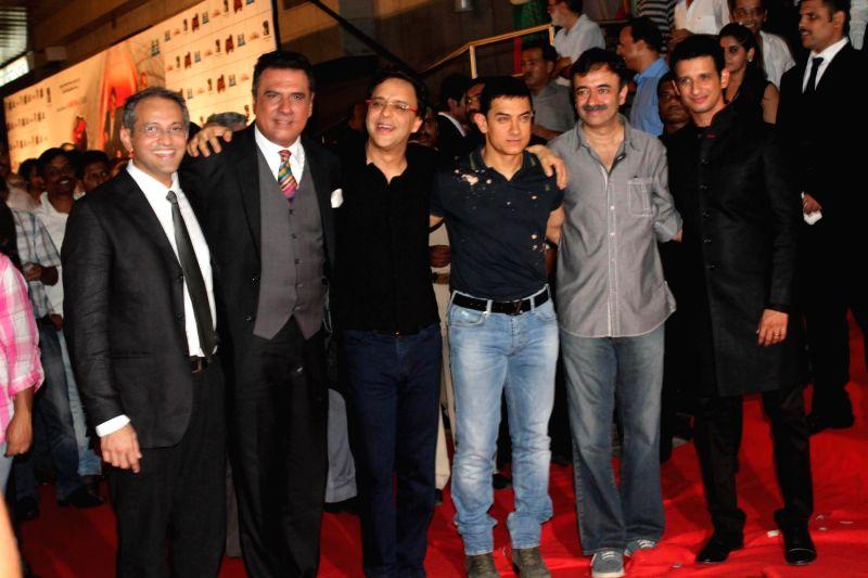 Bollywood actors Boman Irani, Aamir Khan and Sharman Joshi at the premiere of film `Ferrari Ki Sawaari` in Mumbai. - Boman Irani, Aamir Khan and Sharman Joshi