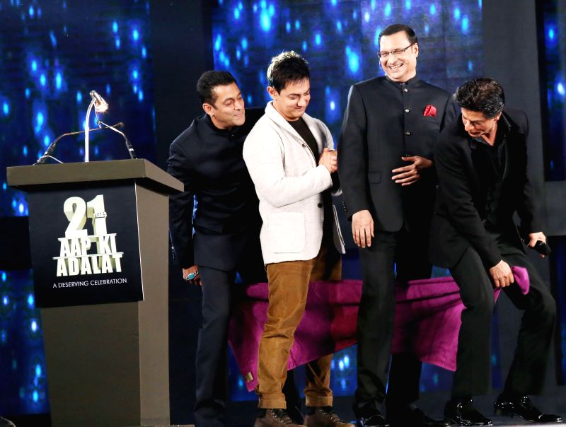 Bollywood actors Salman Khan, Aamir Khan and Shahrukh Khan with Rajat Sharma, Chairman and Editor in Chief of India TV during Aap Ki Adalat's 21st anniversary celebrations in New Delhi on Dec 2, ... - Salman Khan, Aamir Khan, Shahrukh Khan and Rajat Sharma