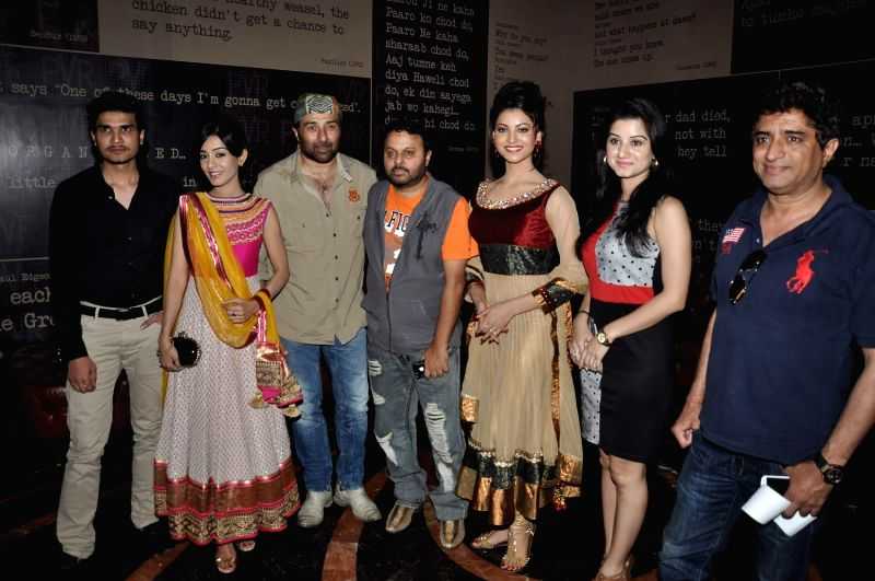 Bollywood actors Urvashi Rautela, film maker Anil Sharma, Sunny Deol, Amrita Rao, Anjali Abrol and music director Anand Raj during the first look of film Singh Saab The Great in Mumbai on August 29, . - Urvashi Rautela, Sharma and Amrita Rao