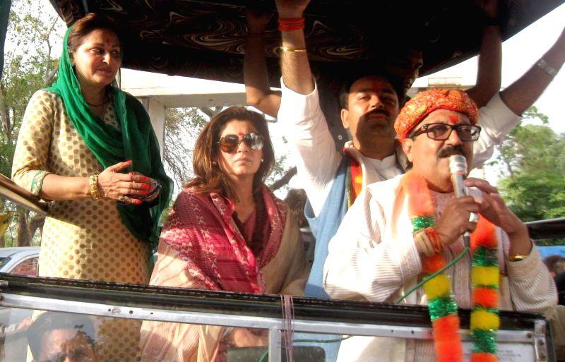 Bollywood actress Dimple Kapadia and Jaya Prada campaigning with Amar Singh who is contesting for Lok Sabha election as Rashtriya Lok Dal (RLD) candidate from Fatehpur Sikri on April 17, 2014.