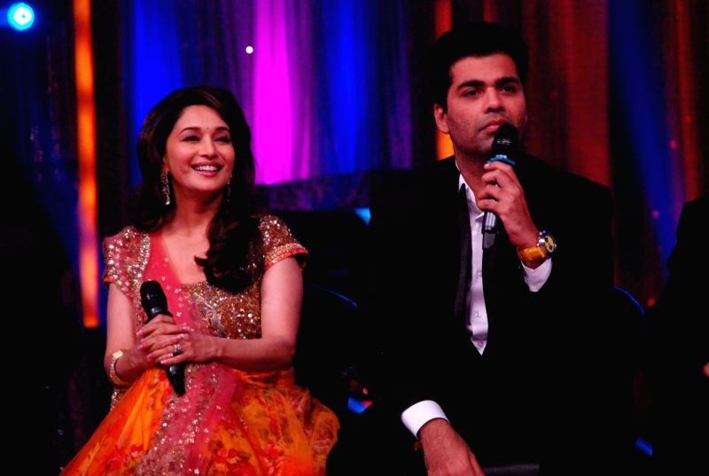 Bollywood actress Madhuri Dixit and filmmaker Karan Johar at the launch of `Jhalak Dikhhla Jaa` Season 5 at Filmistan Studios. - Madhuri Dixit and Karan Johar