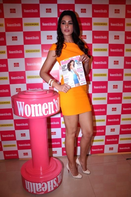 Bollywood actress Nargis Fakhri unveils Women`s Health Magazine June 2012 issue at Crosswards Juhu.