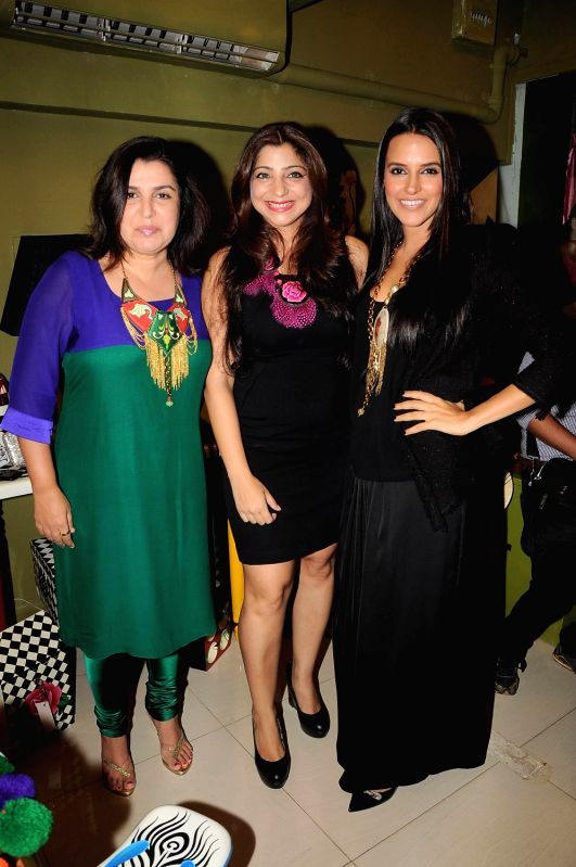Bollywood actress Neha Dhupia and choreographer Farah Khan at the opening of Fluke Store at Andheri, Mumbai. - Neha Dhupia and Farah Khan