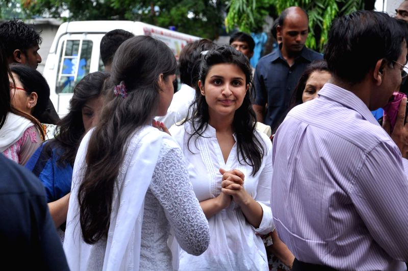 Bollywood actress Parineeti Chopra consoled on the death of her uncle (Priyanka Chopra's father) Ashok Chopra who was cremated in Mumbai on June 10, 2013. - Parineeti Chopra and Ashok Chopra