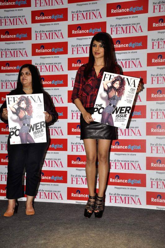Bollywood actress Priyanka Chopra unveils the latest issue of Femina Magazine in Mumbai on September 5, 2013.
