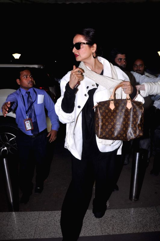 Bollywood actress Rekha leave for IIFA Awards at International Airport. - Rekha