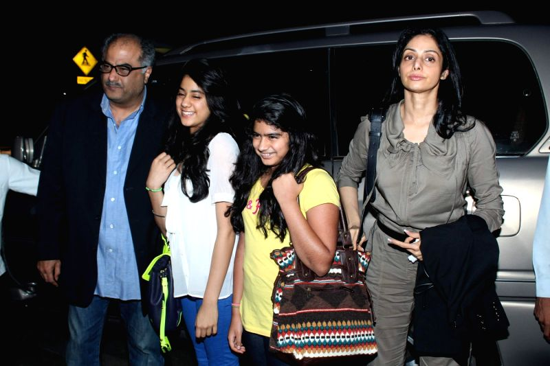 Bollywood actress Sri Devi and Bonney Kapoor leave for 13th IIFA awards to Singapore at International Airport. - Sri Devi and Kapoor