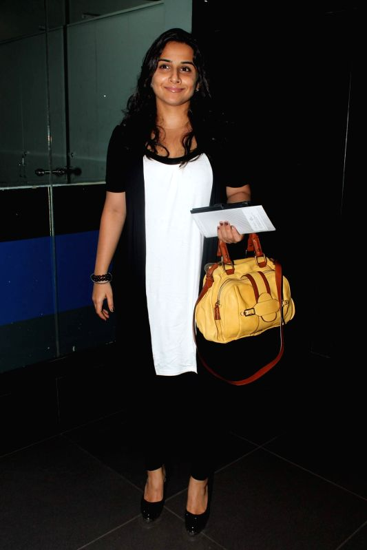 Bollywood actress Vidya Balan at the Mumbai Airport, as she left for Singapore to attend the IIFA Awards 2012. - Vidya Balan