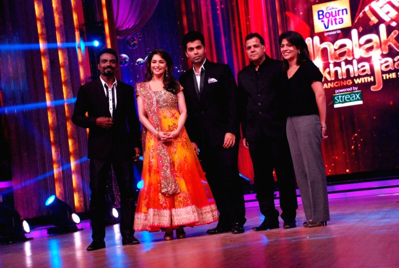 Bollywood choreographer Remo D`Souza, actress Madhuri Dixit and filmmaker Karan Johar at the launch of `Jhalak Dikhhla Jaa` Season 5 at Filmistan Studios. - Madhuri Dixit and Karan Johar