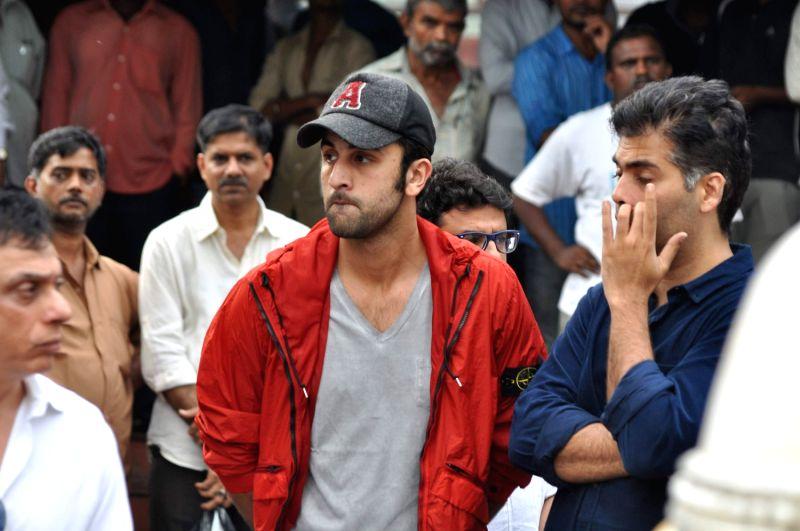 Bollywood filmmaker Karan Johar and actor Ranbir Kapoor attend the funeral of Bollywood actress Priyanka Chopra`s father Ashok Chopra who was cremated in Mumbai on June 10, 2013. - Ranbir Kapoor, Karan Johar and Ashok Chopra