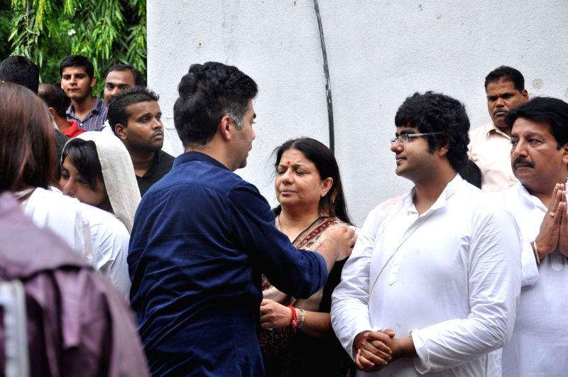 Bollywood filmmaker Karan Johar attend the funeral of Bollywood actress Priyanka Chopra`s father Ashok Chopra who was cremated in Mumbai on June 10, 2013. - Karan Johar and Ashok Chopra