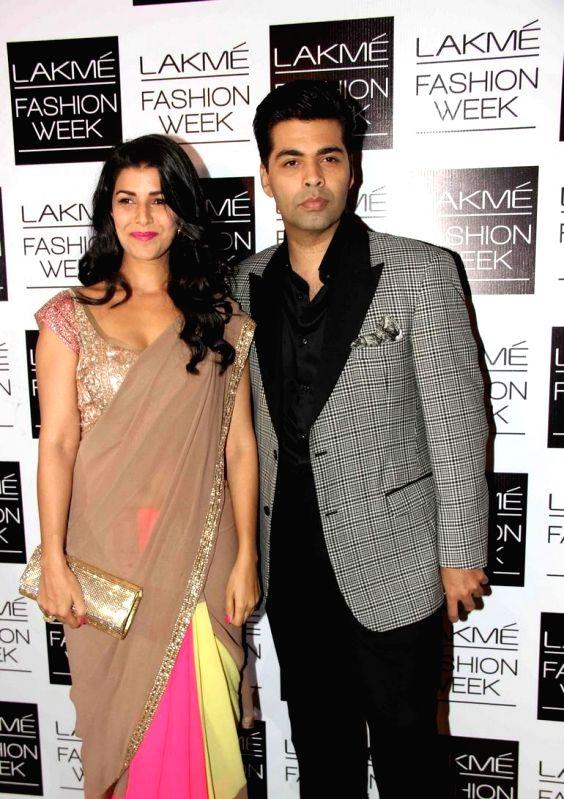 Bollywood filmmaker Karan Johar during fashion designer Manish Malhotra`s show of the Lakme Fashion Week Winter/ Festive 2013 in Mumbai on August 22, 2013. (Photo::: IANS)