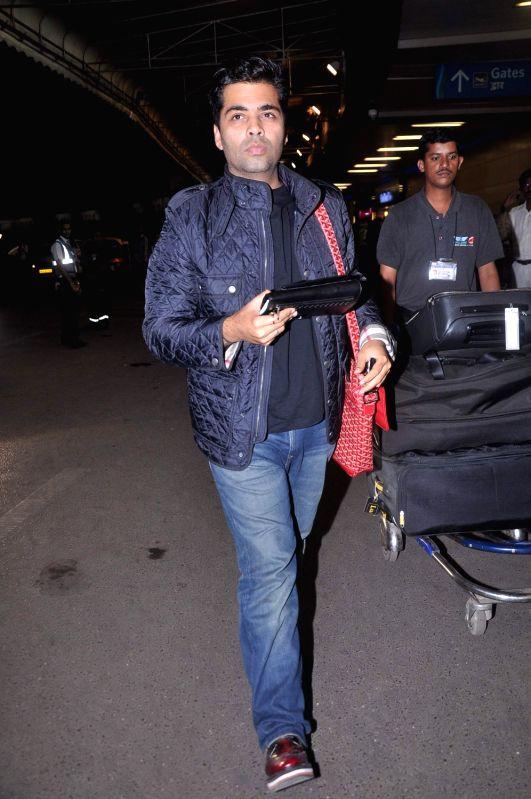 Bollywood  filmmaker Karan Johar leave for London at International Airport.