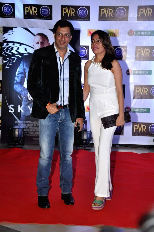 Bollywood filmmaker Madhur Bhandarkar along with his wife Renu Namboodiri pose during the premiere of English film Skyfall at PVR, Kurla in Mumbai.