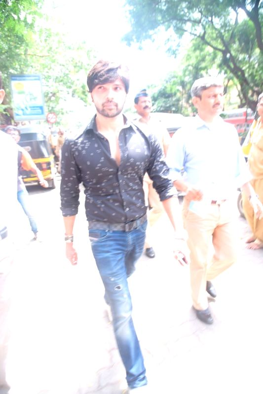 Bollywood music composer and actor Himesh Reshammiya leaves from Bandra family court, in Mumbai, on June 7, 2017. - Himesh Reshammiya