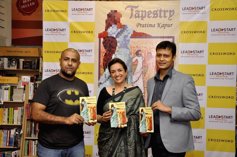 Bollywood music director Vishal Dadlani, author Pratima Kapur and Swarup Nanda Chairman & CEO, Leadstart Publishing during the launch of book Tapestry in Mumbai on May 15, 2014.